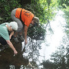 Globe/Roger Nomer<br /> JoAnn Carnagey, Carthage, left, and Val Frankoski, Joplin, collect water samples from Silver Creek.