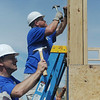 Globe/Roger Nomer<br /> PepsiCo workers Greg Stover, Springdale, Ark., left, and Justin Nield, Miller, work on a Joplin Area Habitat for Humanity house near 24th and Pennsylvania on Saturday morning.  The two joined about 40 volunteers from PepsiCo from around the region to work at three Habitat sites in Joplin.  In addition to the volunteer work day, the PepsiCo Foundation announced earlier this week at grant of $250,000 to Joplin Habitat to help with the expansion of the Habitat ReStore, build homes and help with the start of a new Habitat program to help with exterior repairs to existing homes in the area.