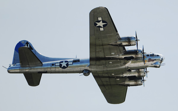 Globe/T. Rob Brown<br /> A B-17 Flying Fortress flies over the Joplin Regional Airport Wednesday morning, June 12, 2013.