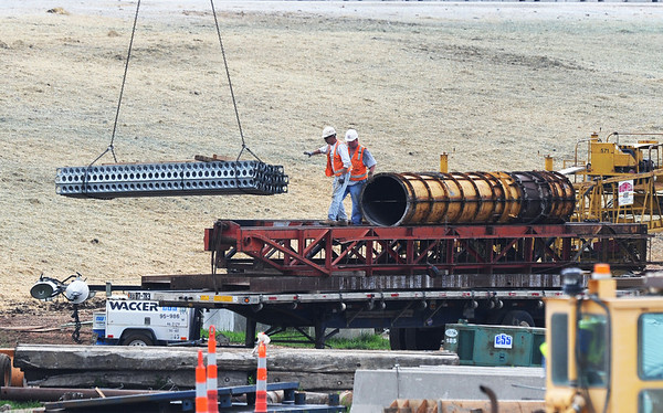 Globe/Roger Nomer<br /> Workers load materials at the site of the new I-44 interchange along Rangeline Road on Tuesday.