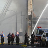Globe/Roger Nomer<br /> A line of firefighters leave the scene of a fire on the Carthage square on Saturday evening.