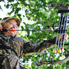 Globe/T. Rob Brown<br /> Jane Mitchell of Carl Junction takes aim with her compound bow Wednesday afternoon, June 12, 2013, from a tree stand on her property.