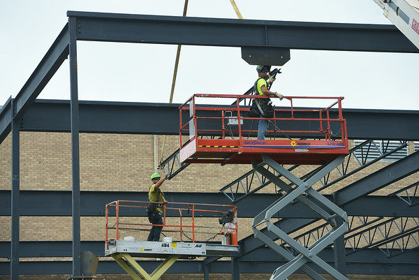 Globe/Roger Nomer<br /> Workers assemble a connecting building to the storm shelter at Webb City High School on Friday.