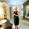 Nancy Morton fixes her hair in the spacious bathroom inside her 112 South Sergeant home in historic Murphysburg.  The home was constructed in 1901 by architect Austin Allen, who also designed the Olivia Apartment Building and City Hall.<br /> Globe | Laurie Sisk