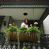 MaryAnne Neff waters flower planters on the porch of her home at 318 South Sergeant in historic Murphysburg. The house, known as the Frye-Basom House, was built in 1891. Neff said she has lived there about 10 years.<br /> Globe | Laurie Sisk