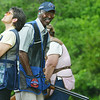 Globe/Roger Nomer<br /> Don Blue, New Braunfels, Texas, smiles as he comes off the course while his wife Mary Beth watches targets at Claythorne Lodge on Wednesday.
