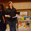 Globe/Roger Nomer<br /> Brandy Pryor, left, and Cari Rerat help present the Little Blue Bookshelf to the Ronald McDonald House on Thursday morning. Pryor and Rerat are project co-chairs with Leadership Joplin.