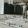 Globe/Roger Nomer<br /> Cherokee County Commissioners Bob Kmiec, left, and Tom Moody look over the interior of Camptown park during a tour on Friday. The beams running along the floor will accommodate large numbers slot machines.