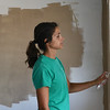 Globe/Roger Nomer<br /> Jessica Johnson, Springfield, paints the interior of a house on Picher on Tuesday morning. Johnson is an Americorp volunteer with Rebuild Joplin who also ran the Joplin Memorial Half Marathon last month.