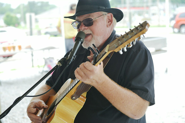 Globe/Roger Nomer<br /> William Adkins, Rogers, Ark., performs at the Webb City Farmers Market on Friday afternoon.