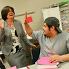 Globe/Roger Nomer<br /> Crowder College President Jennifer Methvin gives a high five to CNA student Jerry Sparlin during a visit to the class on Wednesday.