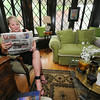 Nancy Morton reads the moorning paper inside her 112 South Sergeant home in historic Murphysburg.  The home was constructed in 1901 by architect Austin Allen, who also designed the Olivia Apartment Building and City Hall.<br /> Globe | Laurie Sisk