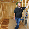 Builder Matt Harris, of Fox Creek Construction talks about the philosophy behind a unique house at 25th and Pennsylvania streets on Wednesday. Harris said building up rather than out was the best option for the small lot.<br /> Globe | Laurie Sisk
