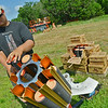 Globe/Roger Nomer<br /> Jordan Dinnsen, Oronogo, refills clay targets at Claythorne Lodge during the US Open on Wednesday.