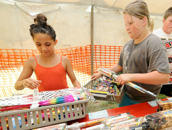 From the left: elelen-year-old Bailey Rowe, 11 and twelve-year-old Omri Elliottm shop fpor fireworks at American Fireworks, North Main and Fountain Road n Sunday. <br /> Globe | Laurie Sisk