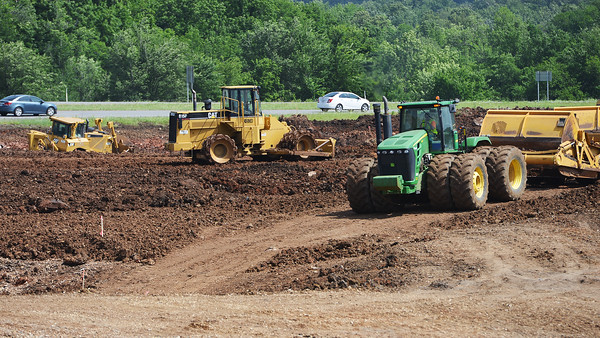 Globe/Roger Nomer<br /> Construction crews move dirt along 171 Highway as work continues on the interchange on Tuesday morning.