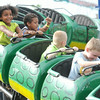 From the left: Nahalna Witherspoon, 4, Nathaniel Witherspoon, 2, Eli Goff, 3 and Brice McCool, 5, enjoy a ride on one of the kiddie rides on Friday at Galena Days.<br /> Globe | Laurie Sisk