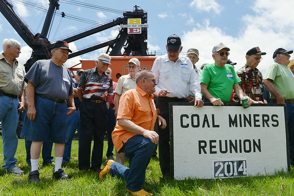 Globe/Roger Nomer<br /> Miners gather for a group photo in front of Big Brutus during their reunion on Saturday, June 7.