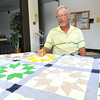 Rocky Biggers points out his father, Raymond Painter's signature on a quilt that was lost in the May, 2011 tornado and recently returned to him.<br /> Globe | Laurie Sisk