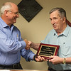 Globe/Roger Nomer<br /> Randy Moore, president of Eagle Picher, recognizes Jack Brill for his over 50 years of service to the company on Thursday.