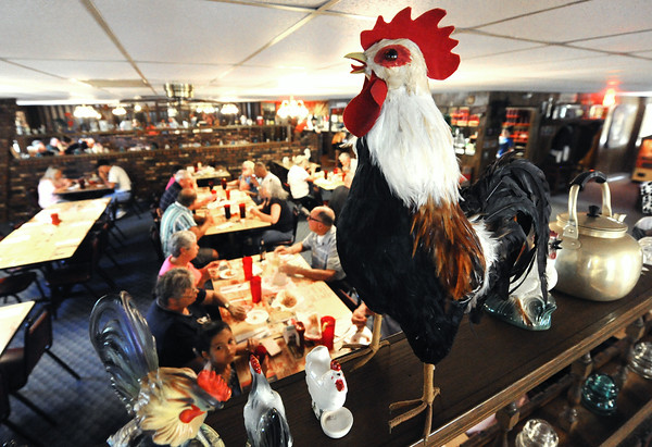 A rooster keeps watch as Chicken Annie's begins to fill on a bust Saturday night. The restaurant, which is located north of Fronetenac is preparing to celebrate its 80th anniversary.<br /> Globe | Laurie Sisk