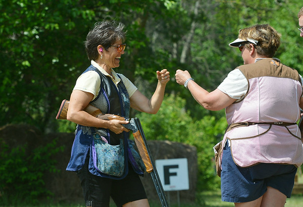 Globe/Roger Nomer<br /> Mary Beth Blue, New Braunfels, Texas, left, gets a fist bump from Norette Underwood, Harrisburg, Ark., after she shot well on the course at Claythorne Lodge on Wednesday.