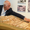"""Globe/Roger Nomer<br /> Moshe Safdie talks about the model for his proposal of the Western Wall Precinct during a tour of his exhibit """"Global Citizen"""" at the Crystal Bridges Museum on Wendesday."""