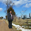 Globe/Roger Nomer<br /> Yer Yang looks over her former farm near Cassville on Feb. 14, 2014.