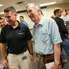 "Globe/Roger Nomer<br /> In a room crowded with coworkers and friends, Jack Brill talks with Matt Housh, left, program manager at Eagle Picher, during his retirement ceremony on Thursday. ""I've been here 10 years,"" said Housh. ""I've worked with Jack, everyone has worked with Jack."""