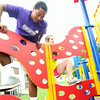 From the left: Joplin Parks and Recreation Instructors DeVaughn Simmons, 17 and Lenée Gibson, 17, test new playground equipment at the Carver Memorial Nursery on Monday. The equipment will be used by children at the Summer Fun Day Camp, which began Monday and continues through Aug 8. Information on how to enroll children for one or multiple weeks may be obtained at  Joplin Parks and Recreation.<br /> Globe | Laurie Sisk