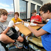 From the left: Connor Yantis, 12, Coleman Yantis, 14, AJ Woods, 12 and Julian Garrett, 12 learn a little about science and cooking as they study the properties of emulsification during a cooking class on Tuesday at The Bruncheonette. More than 20 teenagers got tips and cooking facts from owner Sean Flanagan as part of the Joplin Public Library's summer teen program, Create a Spark.<br /> Globe | Laurie Sisk