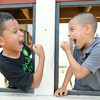Eight-year-old Andres Cazares, left and six-year-old José Cazares have a little good natured mock fight in the Boomtown feature on Wednesday at Cunningham Park.<br /> Globe | Laurie Sisk