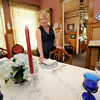 Paula Callihan sets the dining room table in her and her husband Mark's historic house on 108 South Moffett in Murphysburg. The couple bought the house from family after it had been vacant for 18 years.<br /> Globe | Laurie Sisk