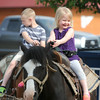Kylee Cupp, 3 and Luke Breeden, 6, enjoy a rdie on the ponies on Friday night at Galena Days.<br /> Globe | Laurie Sisk