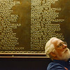 Globe/Roger Nomer<br /> Erik Buck, a volunteer at the National WWI Museum in Kansas City, rests between tours in front of plaques bearing the names of Kansas Citians killed fighting in the war.