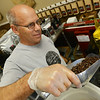 Globe/Roger Nomer<br /> Dennis Posterick watches the scale as he measures Sumatra coffee beans at Signet Coffee in Pittsburg on Monday afternoon.