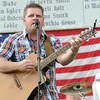 Livewire lead singer Andy Eutsler entertains the crowd on Friday night at Galena Days.<br /> Globe | Laurie Sisk