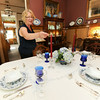 Paula Callihan lights a candle in the dining room of her and her husband Mark's historic house on 108 South Moffett in Murphysburg. The couple bought the house from family after it had been vacant for 18 years.<br /> Globe | Laurie Sisk