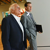 Globe/Roger Nomer<br /> Architect Moshe Safdie takes a tour of the galleries at Crystal Bridges Museum with Executive Director Rod Bigelow on Wednesday afternoon.