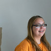 Globe/Roger Nomer<br /> Instead of eye black, volunteer Makella Coulson, 15, Grain Valley, sports eye white while painting a house with Rebuild Joplin on Tuesday.