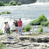 Visitors walk among the lush green vegetation at Grand Falls on Friday. Recent rains have nearly lifted the area out of drought conditions.<br /> Globe | Laurie Sisk