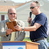 Farmers Insurance CEO Jeff Dailey, right, presents Joplin Mayor Mike Seibert with the company's first Resilient Community Award during a ceremony Tuesday morning at 2423 Picher Ave.<br /> Globe | Laurie Sisk