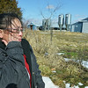 Globe/Roger Nomer<br /> Yer Yang wipes away tears as she looks at her former farm near Cassville on Feb. 14, 2014.