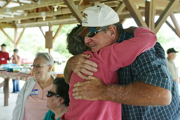 Globe/Roger Nomer<br /> Paul Grant, West Mineral, hugs Shirley Davis, Bernice, Okla., during the miners reunion at Big Brutus on Saturday, June 7. Grant is a former miner, while Davis helped build Big Brutus.