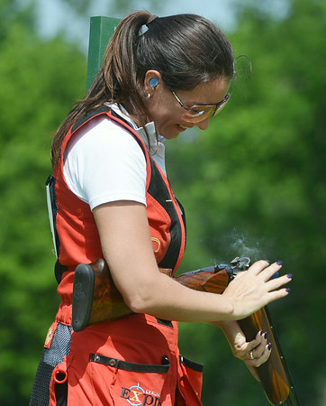 Globe/Roger Nomer<br /> Tanya Faulds, Newbury, England, reloads while competing at the US Open at Claythorne Lodge on Wednesday morning. Faulds is an accomplished international clay shooter from England.