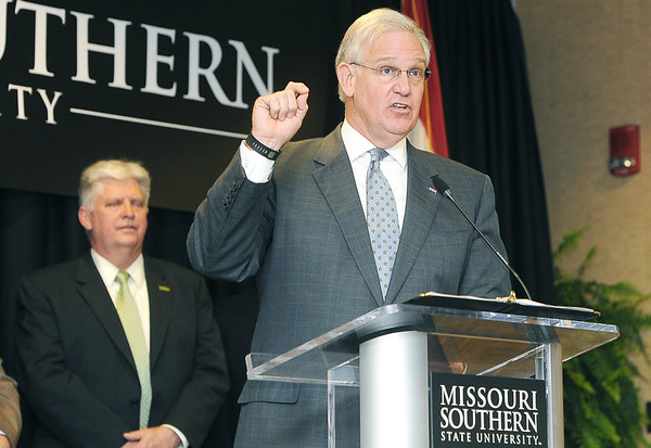 Missouri Gov. Jay Nixon, flanked by Missouri Southern President Alan Marble, contrasts the state of Missouri with neighboring states on budgetary issues facing education before signing a bill that would add $262 million for improvement projects to the state's universities, including $16 million to MSSU.<br /> Globe | Laurie Sisk