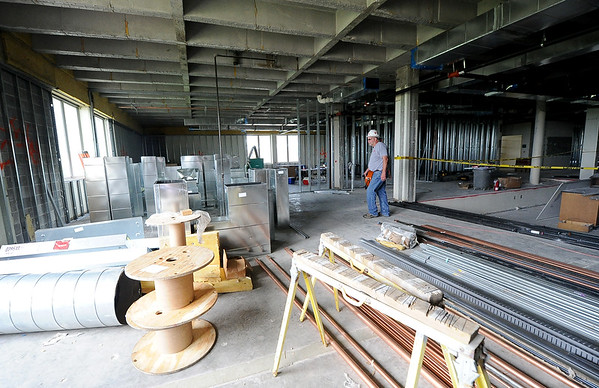 Randy Gunlock, job supervisor for Crossland Construction, walks near HVAC ducts waiting for installation on the third floor of Missouri Southern's Reynolds Hall on Wednesday.<br /> Globe | Laurie Sisk