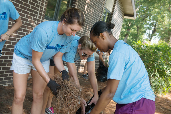 Globe/Roger Nomer<br /> (from left) Missouri Southern basketball players Amelia Bramer, a senior from Mt. Vernon, Chelsey Henry, a sophomore from Neosho, and Jasmine Green, a junior from Houston, help landscape at the Children's Center on Friday as part of the United Way's Day of Action.