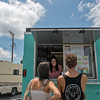 Globe/Roger Nomer<br /> Sarah Carney waits as Cameron Heilig and Chelsea O'Neil decide on their order at Pineapple Bliss on Tuesday.