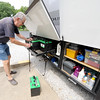 Full-time RVer Allen Anglin changes out one of the six batteries in his RV - two for the engine and four for the vehicles accessories.<br /> Globe | Laurie Sisk